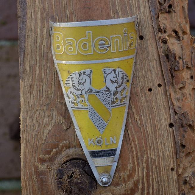 Steuerkopfschild BADENIA, Köln, gelb, 30-50er Jahre, Originalschild aus Sammlungsbestand