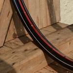 """Fahrradfelge 28"""" x 1,75 (ISO/ETRTO 622mm), schwarz, 36 Loch, Dek.11 rot weiss"""