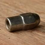Hutmutter , lange Ausführung (30mm)für Sattelklemmbolzen, orig. Altbestand