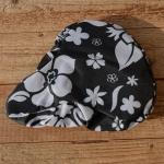 Sattelbezug schwarz-weiß, floral gemustert