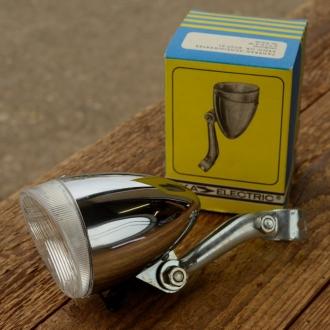 "Scheinwerfer ""FER / AKA ELECTRIC"", Metall verchromt, D=60mm, L=90mm, incl. Halter, orig. Altbestand"